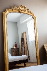 big wooden framed mirror in Paris luxury apartment