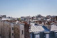 stunning view from the sky-high terrace in Paris luxury apartment