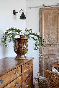 a charming living room with antique wooden chest and cabinets in Paris luxury apartment