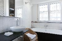 elegant bathroom with a roll-top bath in Paris luxury apartment