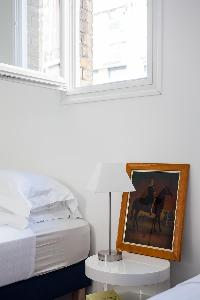 clean and crisp bedroom linens in Paris - Rue Michel-Ange II luxury apartment