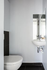 fresh and neat bathroom in Paris - Rue Michel-Ange II luxury apartment