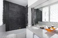 stylish bath with integrated shower in Paris luxury apartment