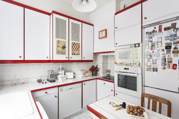 retro kitchen in red and white hues in Paris luxury apartment