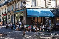 Montmartre neighborhood surrounded by a variety of shops, restaurants, and cafés close to Paris luxu