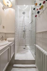white-tiled shower area in Paris luxury apartment