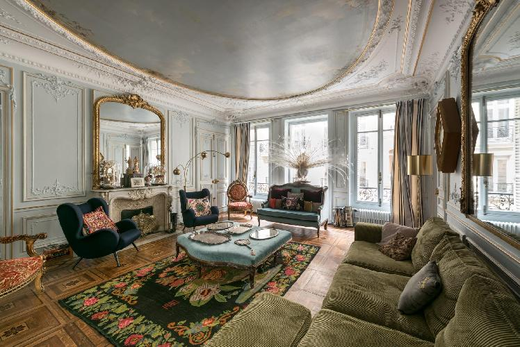 a classic and elegant 3-bedroom Paris luxury apartment with its paneled walls, ornate mirrors, and a