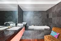 awesome bathroom with tub in Paris - Rue Montorgueil luxury apartment