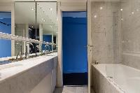 blue and beige bath in a Paris luxury apartment