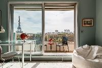 spectacular views along the Seine to the iron silhouette of the Eiffel Tower from the balcony of a P