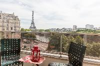 Eiffel tower view from a cozy balcony in a Paris luxury apartment