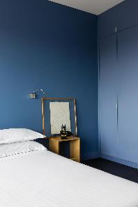 blue and white bedroom in a Paris luxury apartment