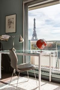 spectacular views along the Seine to the iron silhouette of the Eiffel Tower from the bedroom with g