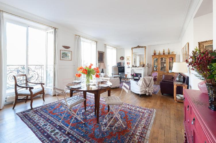 2-bedroom Paris luxury apartment designed with a delicate luster of its raw silk drapes, original pa