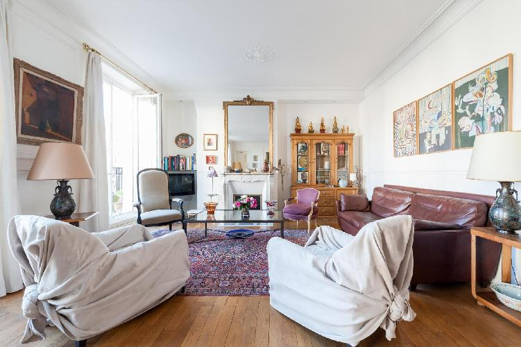 2-bedroom Paris luxury apartment dotted with ceramics and treasures from Singapore, London, and Laos
