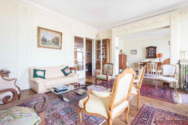 classic and elegant 3-bedroom Paris luxury apartment with high ceilings, full-length windows, and tu