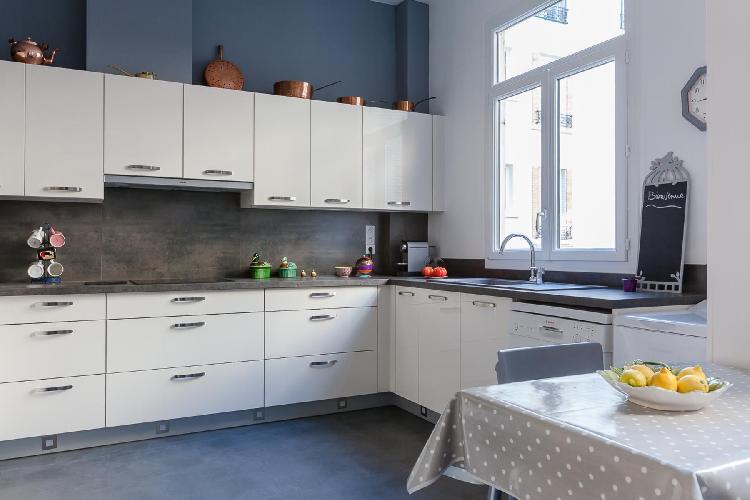 sleek gray-and-white kitchen in Paris luxury apartment
