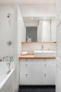 cool bathroom with tub in Paris - Square Alboni luxury apartment