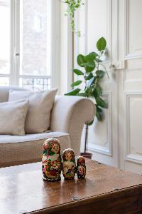 set of figurine on top of a wooden coffee table in Paris luxury apartment