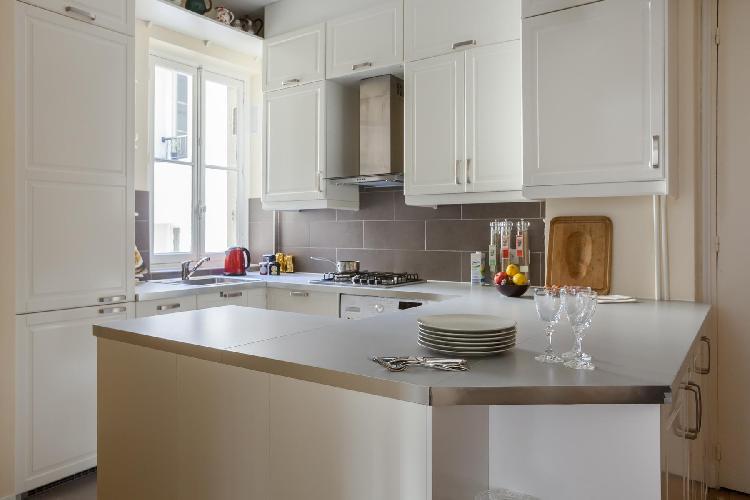 sleek kitchen in neutral tones in Paris luxury apartment