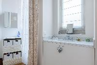 an ensuite shower room in a 2-bedroom Paris luxury apartment