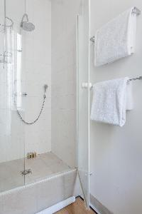 a shower area in a 2-bedroom Paris luxury apartment