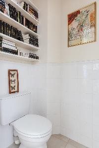 toilet with shelves in a 2-bedroom Paris luxury apartment