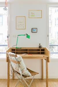 wooden desk and green lamp in Paris luxury apartment