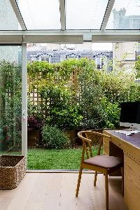 secluded terrace with contemporary table for 4 in Paris luxury apartment