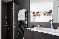 charcoal-colored sleek shower area in Paris luxury apartment
