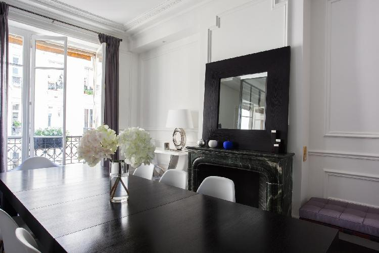 lovely dining room with a gleaming contemporary table and ornamental marble fireplace in a 3-bedroom