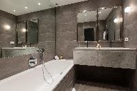 awesome bathroom with tub at Paris - Rue du Bac VI luxury apartment