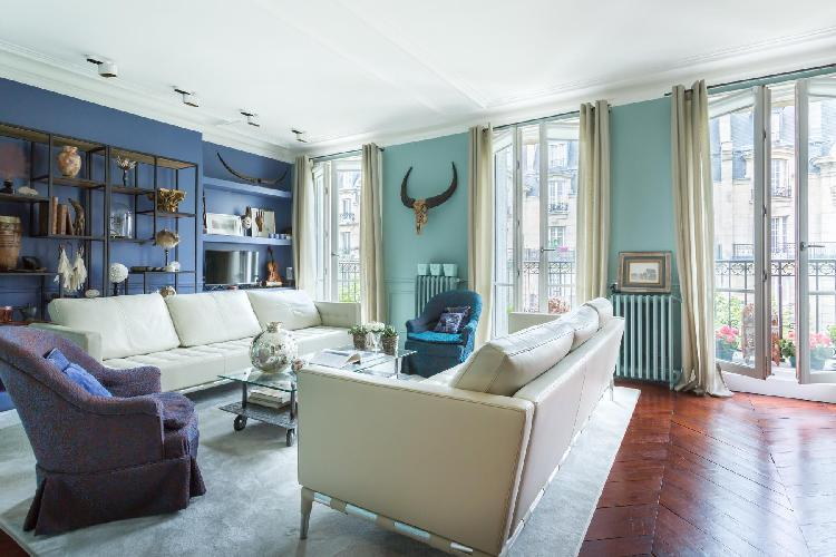 colorul and curio-filled sitting room in a 2-bedroom Paris luxury apartment