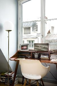 study with white Eames chair in Paris luxury apartment