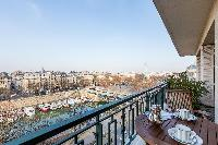 view of Seine river from a balcony of Paris luxury apartment