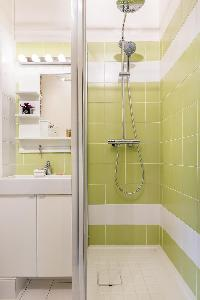 lime tiled shower area in Paris luxury apartment