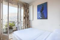 comfy bed with access to the balcony with view of Paris