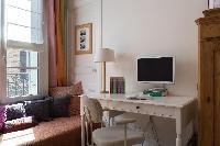 white study and window seat in Paris luxury apartment
