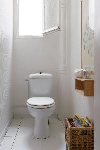 white-tiled toilet in Paris luxury apartment