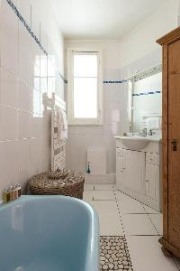 powder blue bathtub in Paris luxury apartment