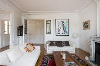 sets of white sofa and honeyed wood coffee table in Paris luxury apartment