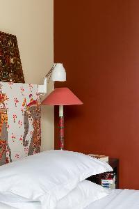 crisp and clean bedroom linens in Paris - Rue Notre-Dame-des-Champs II luxury apartment