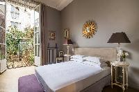 beautiful bedroom with balcony at Paris - Rue du Faubourg Poissonnière IV luxury apartment
