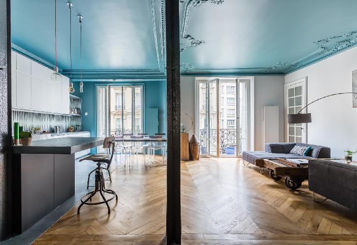 teal-and-white main living area combines sitting, dining and kitchen space and offers a mix of tradi