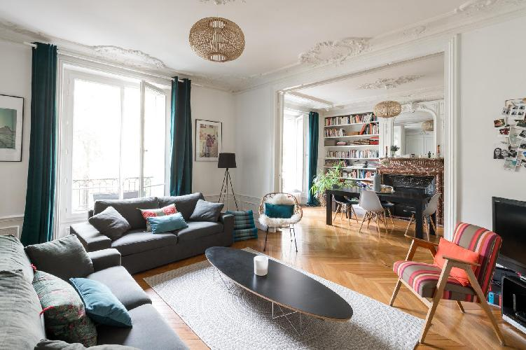 classic and colorful living room furnished with cool pieces and some very bold artworks in Paris lux