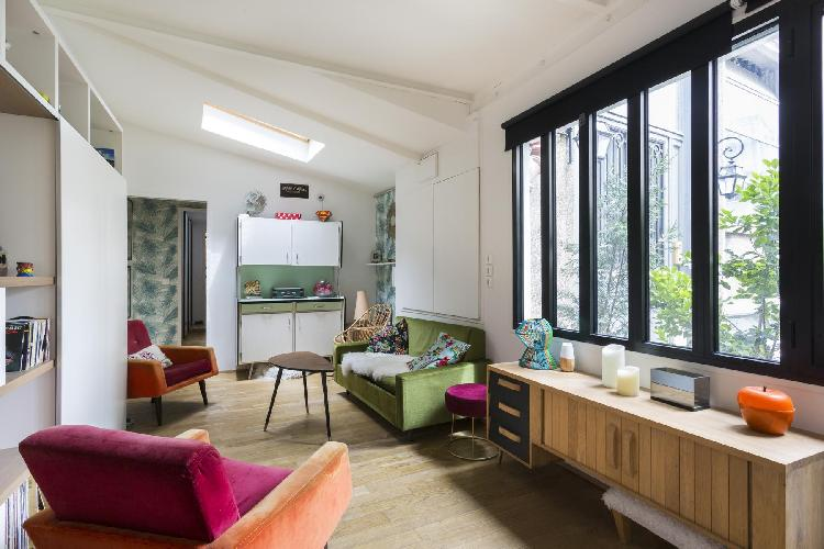 2-bedroom Paris luxury apartment features all industrial-style original details, vintage pieces, and