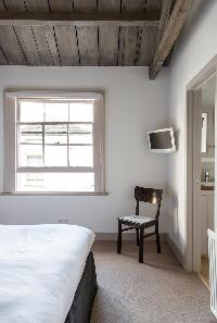 charming country-themed bedroom of South Ken London Ensor Mews luxury apartment