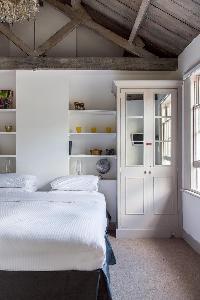 spic-n-span bedroom of London Ensor Mews luxury apartment