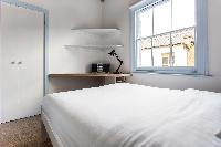 crisp and clean bedroom linens of London Ensor Mews luxury apartment