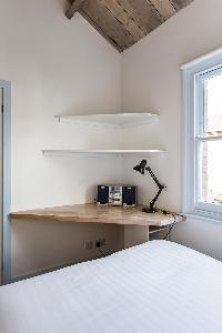 clean and crisp bedroom linens in London Ensor Mews luxury apartment